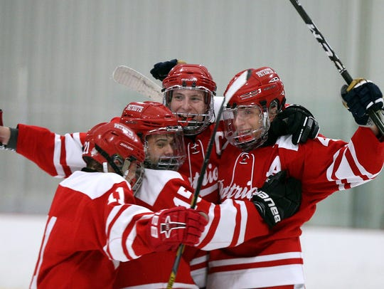 Penfield's Jack Schlifke, right, celebrates his goal
