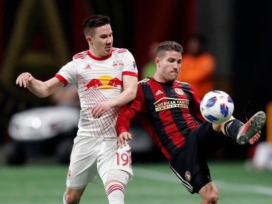 FILE - In this  Sunday, Nov. 25, 2018 file photo, Atlanta United defender Greg Garza, right, controls the ball as New York Red Bulls midfielder Alex Muyl (19) defends In the second half of an MLS soccer playoff game in Atlanta. Cincinnati FC acquired striker Kei Kamara from the Vancouver Whitecaps in the MLS expansion draft and then immediately dealt him to the Colorado Rapids. The team also acquired FC left back Greg Garza from MLS Cup champion Atlanta United for $450,000 in allocation money. (AP Photo/John Bazemore, File)
