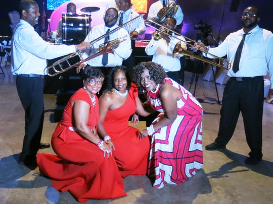 Krewe Sobek Ball Chief Saundra Bigham, Lois Peyton, Cassandra Smith pose with the New Orleans jazz band at the Sobek ball.