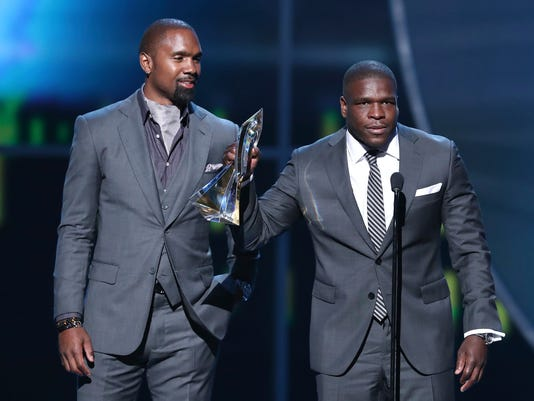 Charles Woodson, Frank Gore