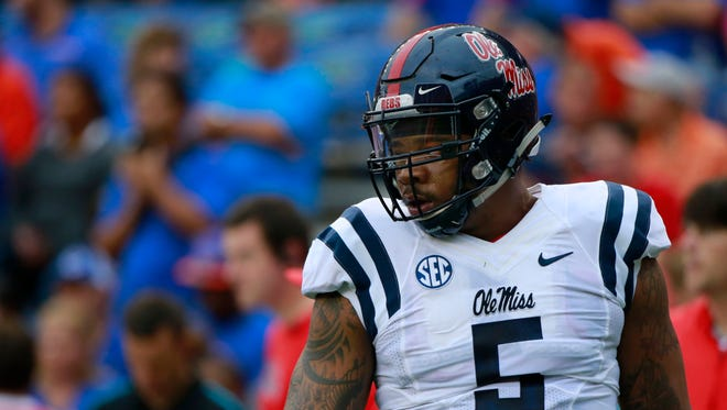 Oct 3, 2015: Mississippi Rebels defensive tackle Robert Nkemdiche (5) looks on prior to the game at Ben Hill Griffin Stadium.