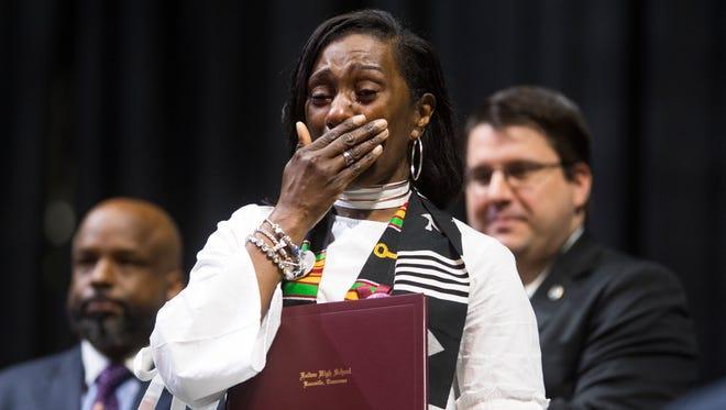 Zenobia Dobson receives her son Zaevion Dobson's diploma at Fulton High's graduation at Thompson-Boling Arena on Thursday, May 17, 2018.