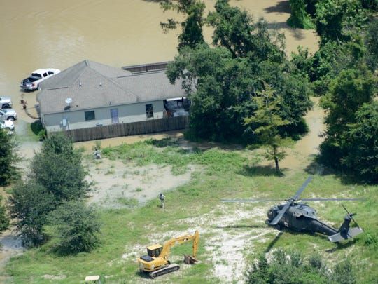 A Louisiana Army National Guard Air MEDEVAC UH-60 Blackhawk crew responds to a call for medical assistance in French Settlement on Aug. 15.