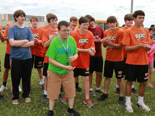 Armondo Sanchez observes drills at the South Gibson All-Star Football Camp while waiting to blow his whistle on Tuesday.