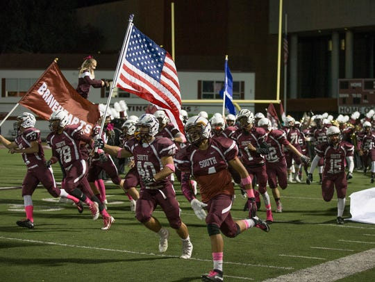 Toms River South Football team heads out onto field.