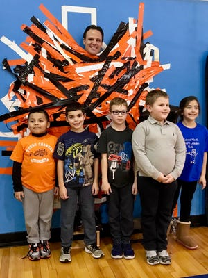School No. 6 Principal William Mastriano with students after being duct-taped to a wall in the school gym to raise money for the school's leadership program. The students are (from left) first-grader Francisco Flores, first-grader Ethan Melendez, second-grader Patryk Bator, first-grader Dominick Skwirz and second-grader Alexia Gutierrez.