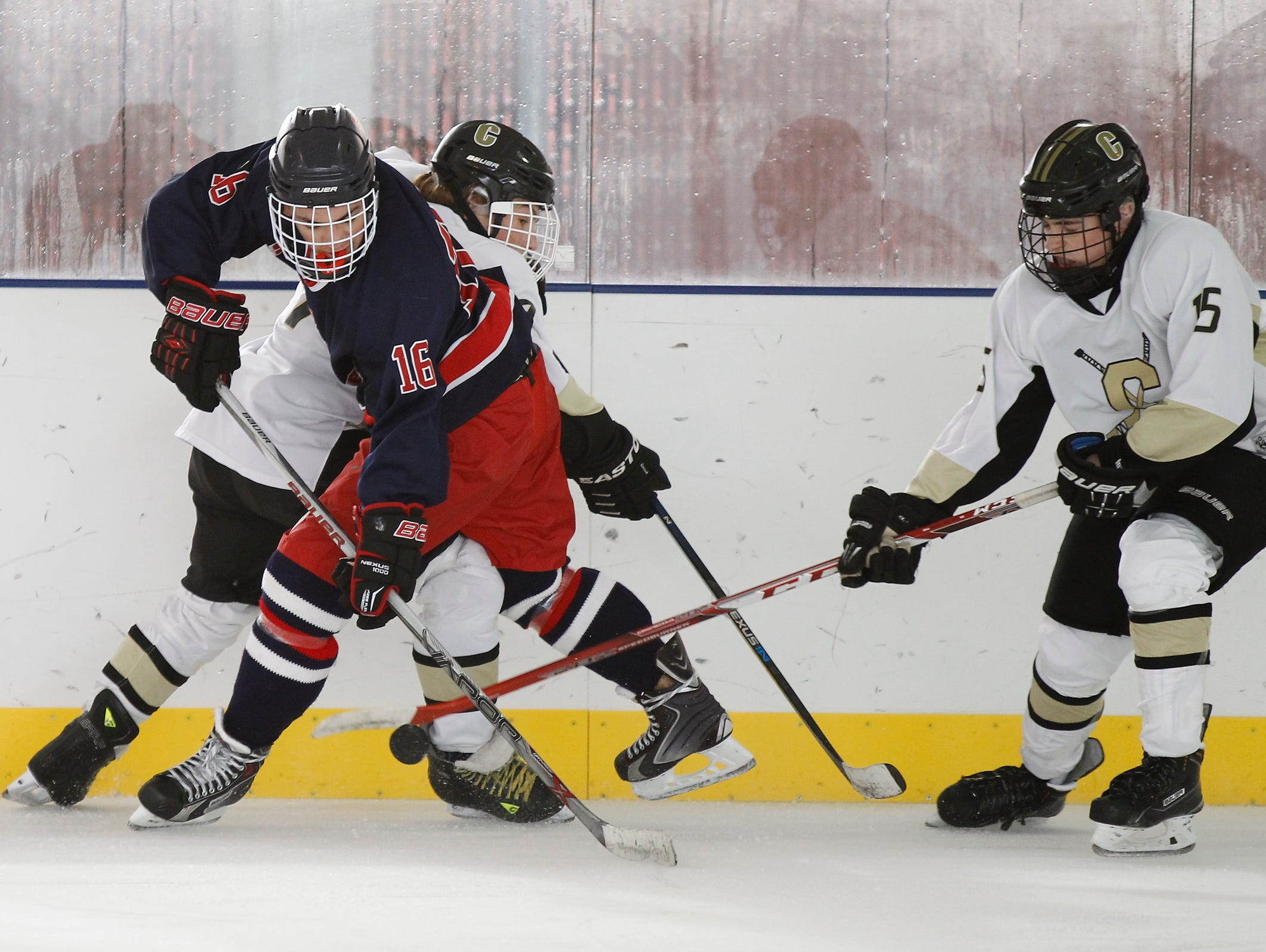 Stepinac's PJ Reith (16) is checked by Clarkstown's Riku Robins (7) during a varsity ice hockey game at the 2015 Guy Matthews Thanksgiving Invitational Hockey tournament at Ebersole Ice Rink in White Plains on Friday, Nov. 27, 2015.