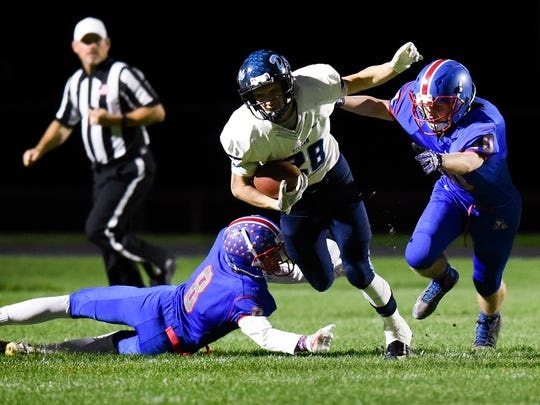 Becker fullback Sidney Boros is brought down by St.