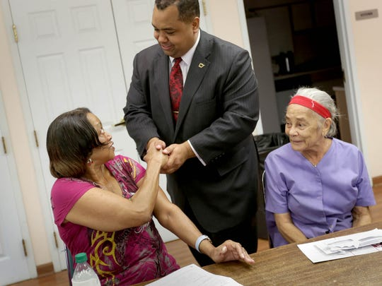 Sen. Coleman Young II greets Earnestine Overtone, 70 as Bobbi Sutton, 85 looks on at Eden Manor, a senior citizen housing development during Young's mayoral campaign in Detroit on Monday, October 30, 2017.