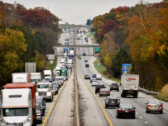I-83's southbound lanes, left, are congested as vehicles