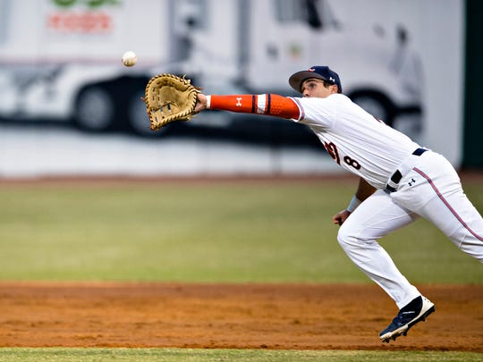 Auburn infielder Brendan Venter fields a ground ball for an out during the Capitol City Classic between Alabama and Auburn on Tuesday, March 27, 2018, in Montgomery, Ala.