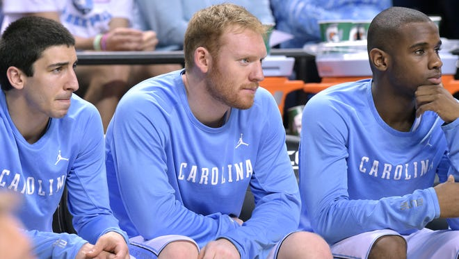 North Carolina's Spenser Dalton, center, is enjoying his time with the Tar Heels after being promoted from junior varsity in February.