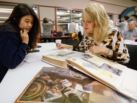 Reporter Alissa Zhu talks with Sally Breck during the