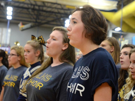 The South Lyon High School choir sings the National