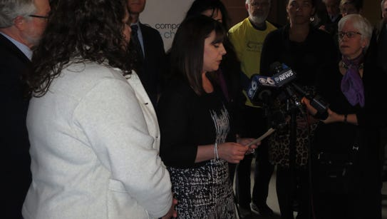 Susan Rahn of Rochester speaks at a news conference