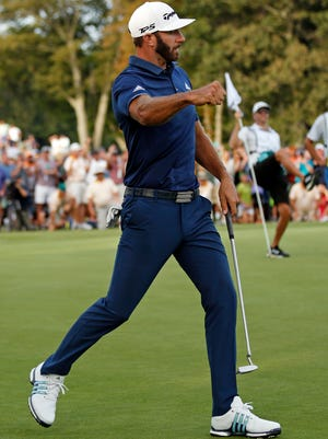 Dustin Johnson reacts after hitting a putt on the 18th green to force a playoff against Jordan Spieth during the final round of The Northern Trust golf tournament on Sunday, Aug. 27, 2017, in Old Westbury, N.Y. (AP Photo/Adam Hunger)