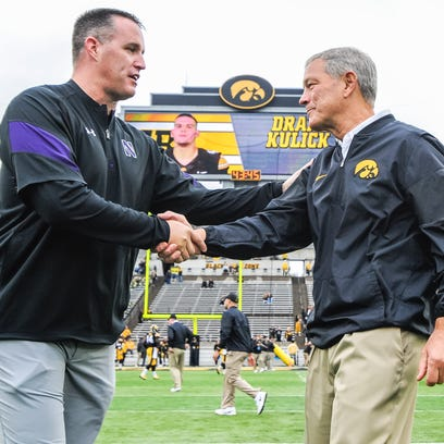 Northwestern's Pat Fitzgerald, left, has a 6-5 record