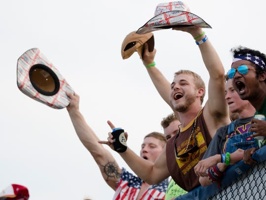 Fans cheer during the NASCAR Monster Series Quaker