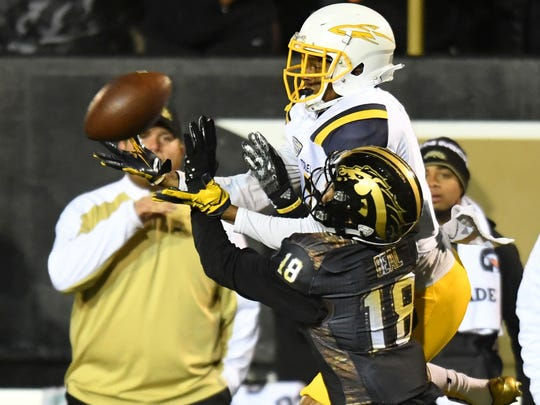 Western Michigan Broncos defensive back Sam Beal (18) defends Toledo Rockets wide receiver Jon'Vea Johnson (7) during the first half at Waldo Stadium on Nov. 25, 2016.
