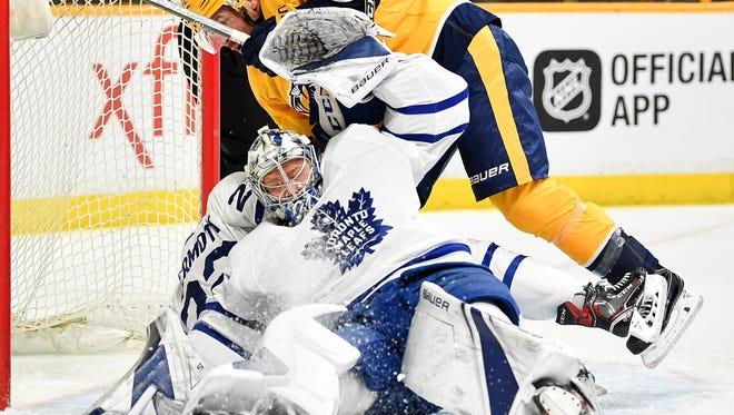 Nashville Predators center Mike Fisher (12) collides with Toronto Maple Leafs goaltender Frederik Andersen (31) for called goaltender interferenceduring the first period at Bridgestone Arena, Thursday, March 22, 2018, in Nashville, Tenn.