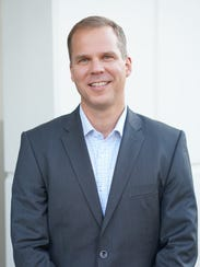 Andy Hinrichs is CEO of AutoGravity.