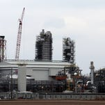 The $2 billion Iowa Fertilizer Co. plant rises from the Green Bay Bottoms in February along the Mississippi River near Wever in the southeast corner of Iowa. An $8 billion deal between CF Holdings and OCI has been canceled as of Monday, May 23, 2016, meaning the Wever plant will still be owned by OCI.