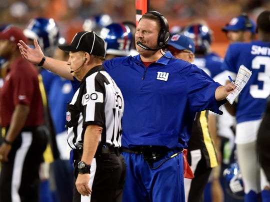 New York Giants head coach Ben McAdoo argues with down judge Mike Spanier in the first half of an NFL preseason football game against the Cleveland Browns, Monday, Aug. 21, 2017, in Cleveland. (AP Photo/David Richard)