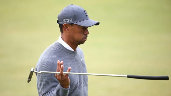 Tiger Woods reacts as he walks off of the 18th green during the first round of the 144th Open Championship at the Old Course on Thursday, July 16, 2015, in St. Andrews, Scotland.