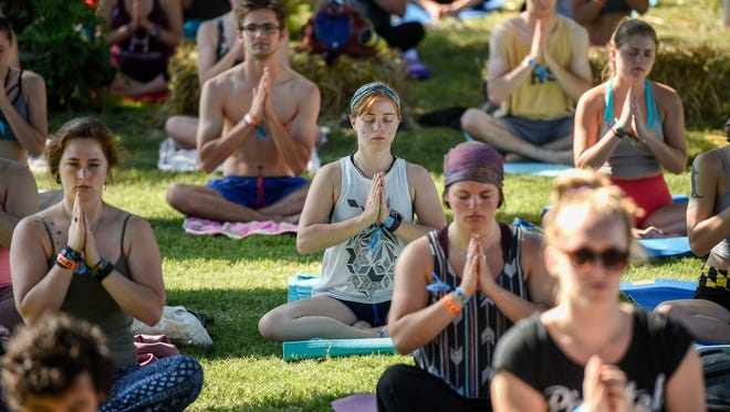 Participate in different kinds of yoga in the Tennessee Yoga Festival at Historic Rock Castle.
