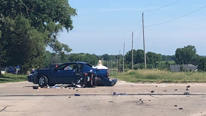 A car and motorcycle involved in a fatal crash in Omro are seen Sunday morning.