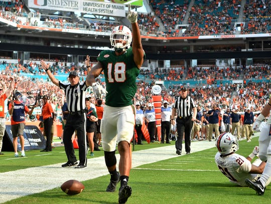 Miami Hurricanes wide receiver Lawrence Cager celebrates