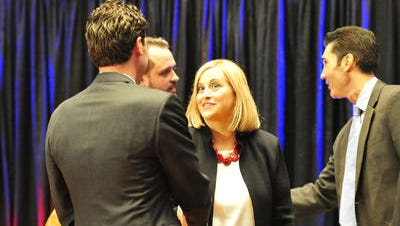 Jeremy Kane shakes hands with Megan Barry at the second of two Tennessean televised debates earlier this year.