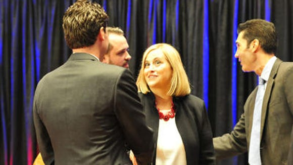Jeremy Kane shakes hands with Megan Barry at the second