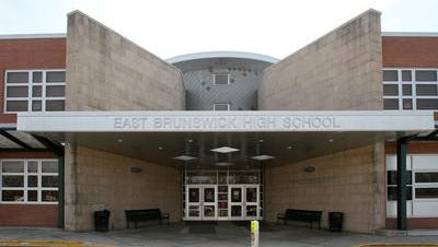 An East Brunswick High School student has been arrested and charged with making terroristic threats online.