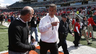Urban Meyer walks off the field at Paul Brown Stadium after Ohio State held its spring game there in 2013.