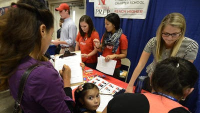 Parents and students visit a Nashville Prep booth at Nashville's school selection fair last fall.