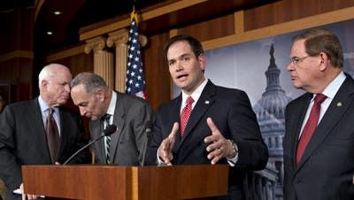 "The four Republican members of the Senate's ""Gang of Eight,"" including Sen. John McCain, left, and Sen. Marco Rubio, second from right, are trying to reassure conservatives that any bill used to address the border crisis will not be used to advance comprehensive immigration reform."