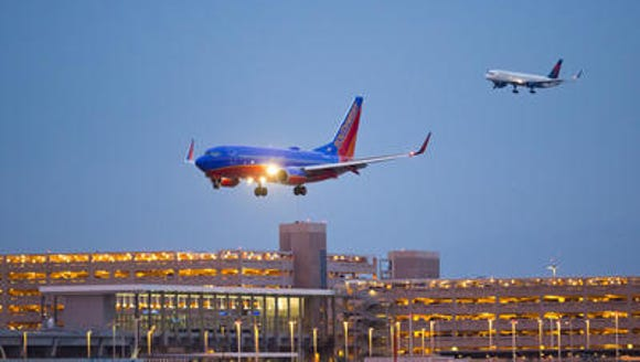 A Southwest Airlines plane lands at Phoenix Sky Harbor International Airport