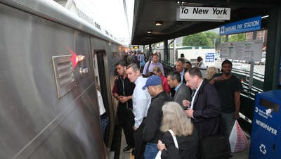 Commuters board a train in Port Chester in this Journal News file photo