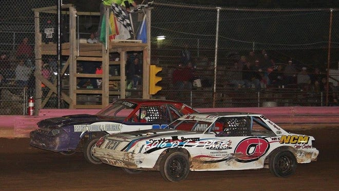 Local drivers Ed Hollenbach (0) and Josh Demmy, left, hit the finish line in the Chargers race at Linda's Speedway on Friday. Demmy won by a nose.