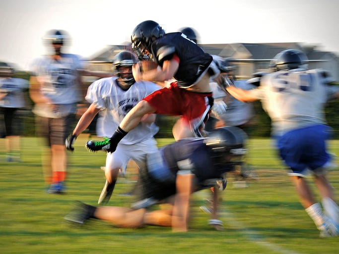Becker running back C.J. Schwintek leaps over a tackler during practice.