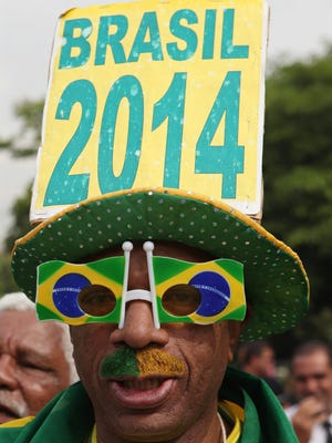 A Brazilian soccer fan is seen during a press conference of the Brazilian national soccer team in Rio de Janeiro. Brazilian national soccer team head coach Luiz Felipe Scolari announced the Brazilian squad for the upcoming FIFA World Cup in Brazil.