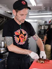 Chef Zane Vicknair prepares food, Friday, Aug. 25,