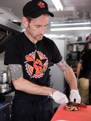 Chef Zane Vicknair prepares food, Friday, Aug. 25, 2017, at Street Kitchen.  [Matthew Dae Smith/Lansing State Journal]
