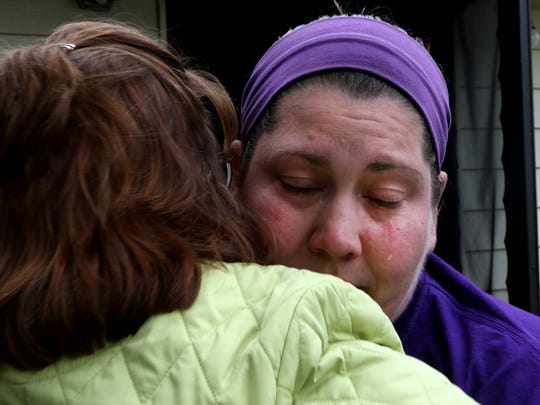 """""""Shh, you kept your head,"""" comforts Carmen Kaumm (L) to Shannon Millard, who saved her neighbor from a house fire earlier May 11, 2016, in Pittsville, Wis. Millard was conflicted because she could not save the neighbor's dog, which perished in the fire."""
