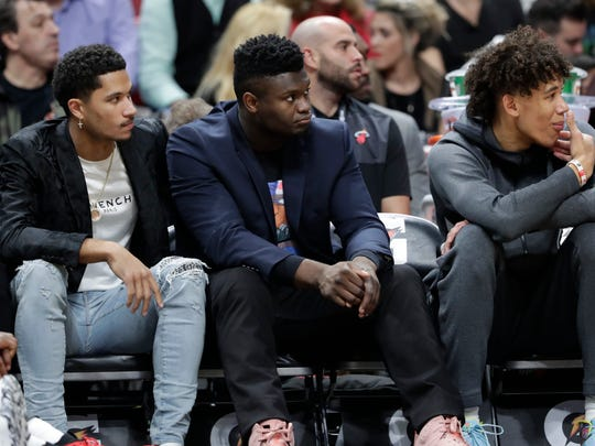 New Orleans Pelicans forward Zion Williamson, center, watches from the bench during the first half of an NBA basketball game against the Miami Heat, Saturday, Nov. 16, 2019, in Miami. (AP Photo/Lynne Sladky)