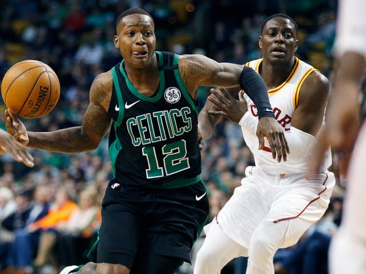 Boston Celtics' Terry Rozier (12) drives past Indiana Pacers' Darren Collison during the first quarter of an NBA basketball game in Boston, Sunday, March 11, 2018. (AP Photo/Michael Dwyer)
