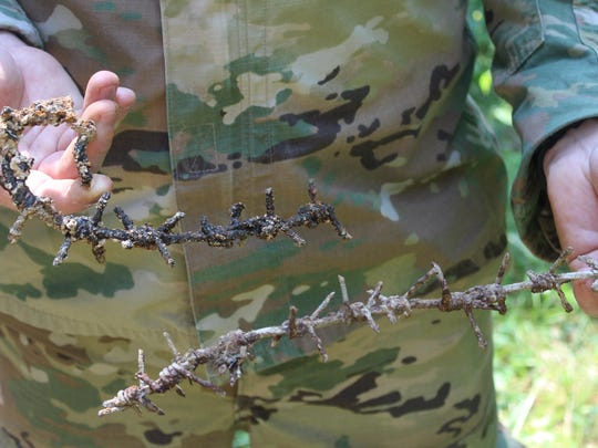 The Vermont group visited the Apremont Forest near the Bois Brule where Cpl. Leonard Lord of Swanton was killed in action. It was amazing how the forest and trenches remained as if the Great War ended a week or so before. Here, Capt. Joe Phelan, Vermont National Guard, holds some barbed wire he found in a trench.