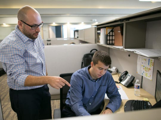 Bob Tantalo of Rochester, left, works with Jamie Donnelly of Pittsford at Conifer Realty in Rochester on Wednesday, September 16, 2015.