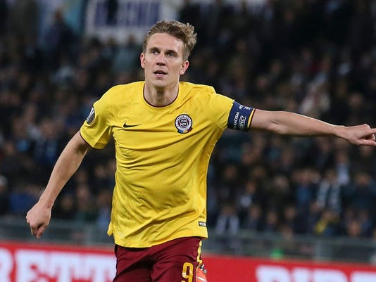 FILE- In this Thursday, March 17, 2016 file photo Sparta Prague's Borek Dockal celebrates after scoring his side's opening goal during the Europa League, round of 16, second-leg soccer match between Sparta Prague and Lazio, at Rome's Olympic stadium. Dockal has agreed on his transfer from Sparta Prague to Henan Jianye in the Chinese Super League. Both clubs confirmed the move on their web sites on Saturday, Feb. 25, 2017. (Alessandro Di Meo/ANSA via AP, File)